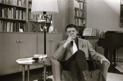 Burgess-Smoking-in-Chair-with-Boots
