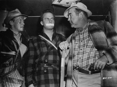 Asserting his authority over William Talman and Ralph Meeker in Big House U.S.A. (1955)
