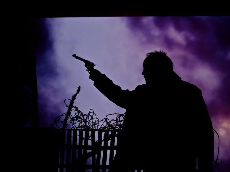 Udo Kier gun photo by Kim Morgan
